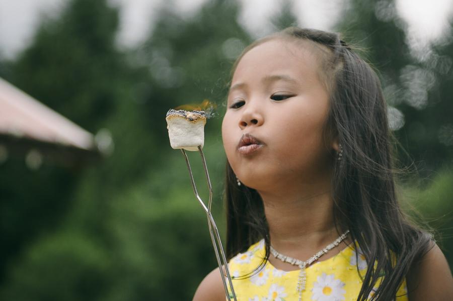 56 flower girl roasting marshmallows