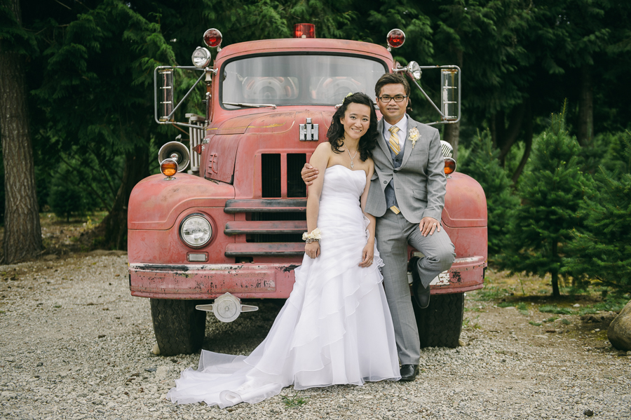 60 bride and groom old red fire truck portrait