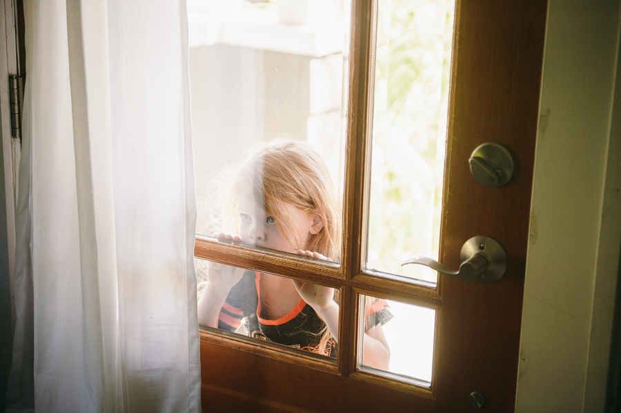 6-flower-girl-looking-through-window