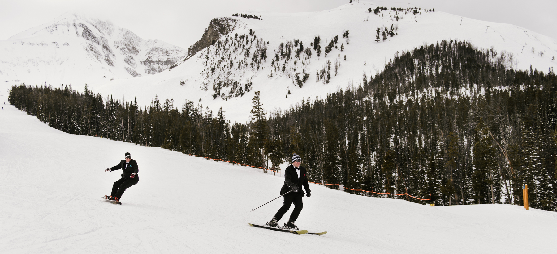groomsmen skiing down big sky