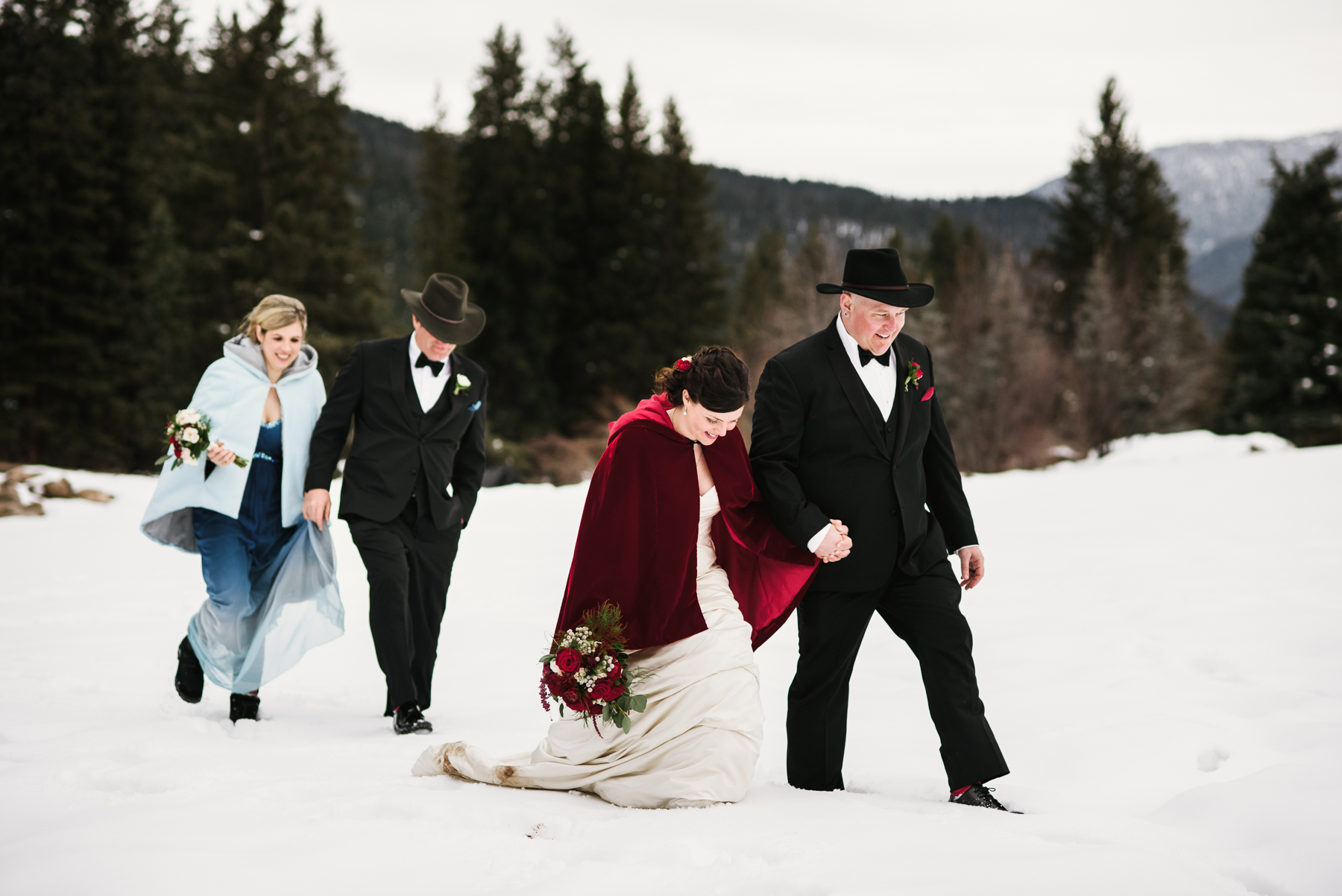 rainbow ranch bridal party walking in snow