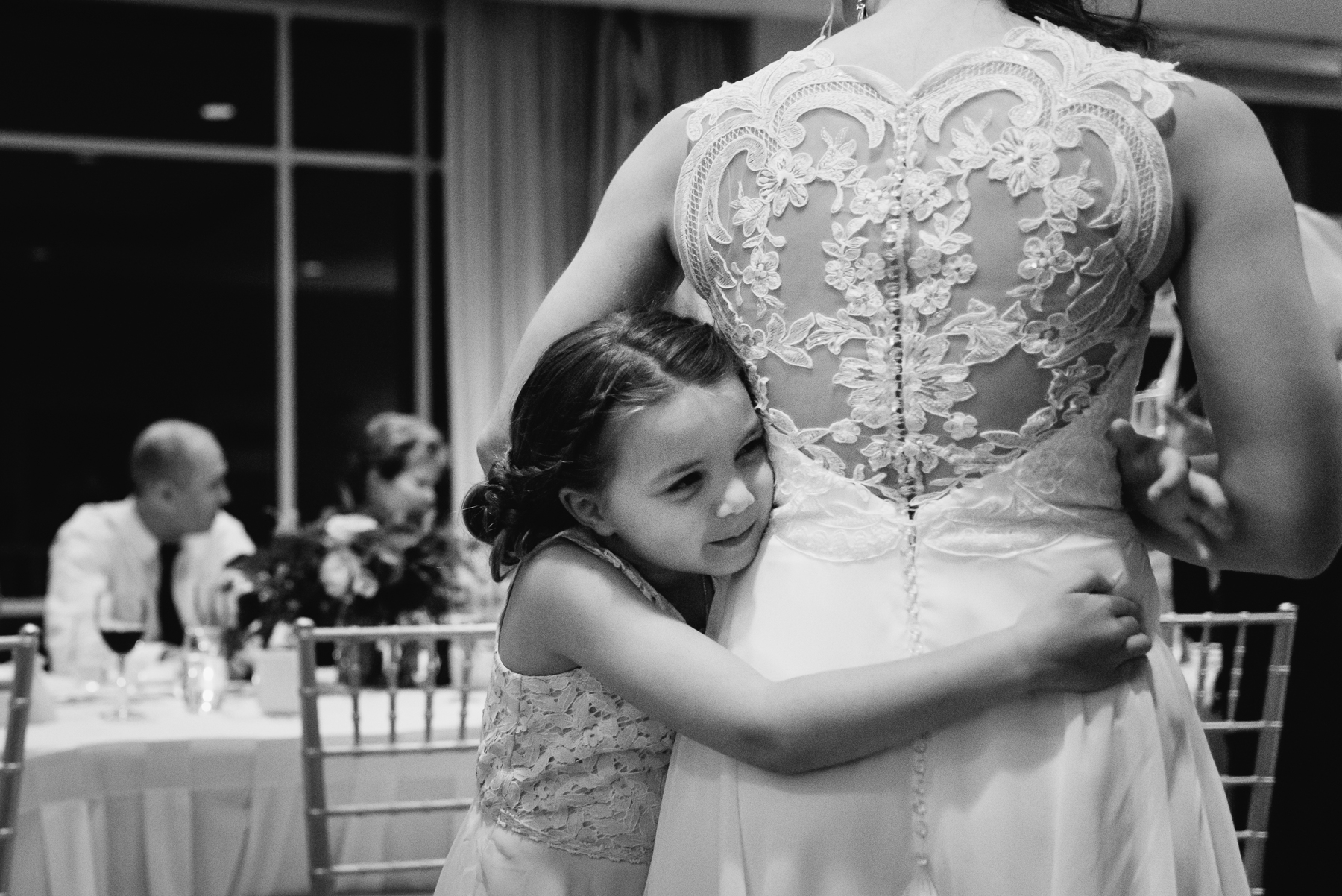 flower girl and bride hugging moment