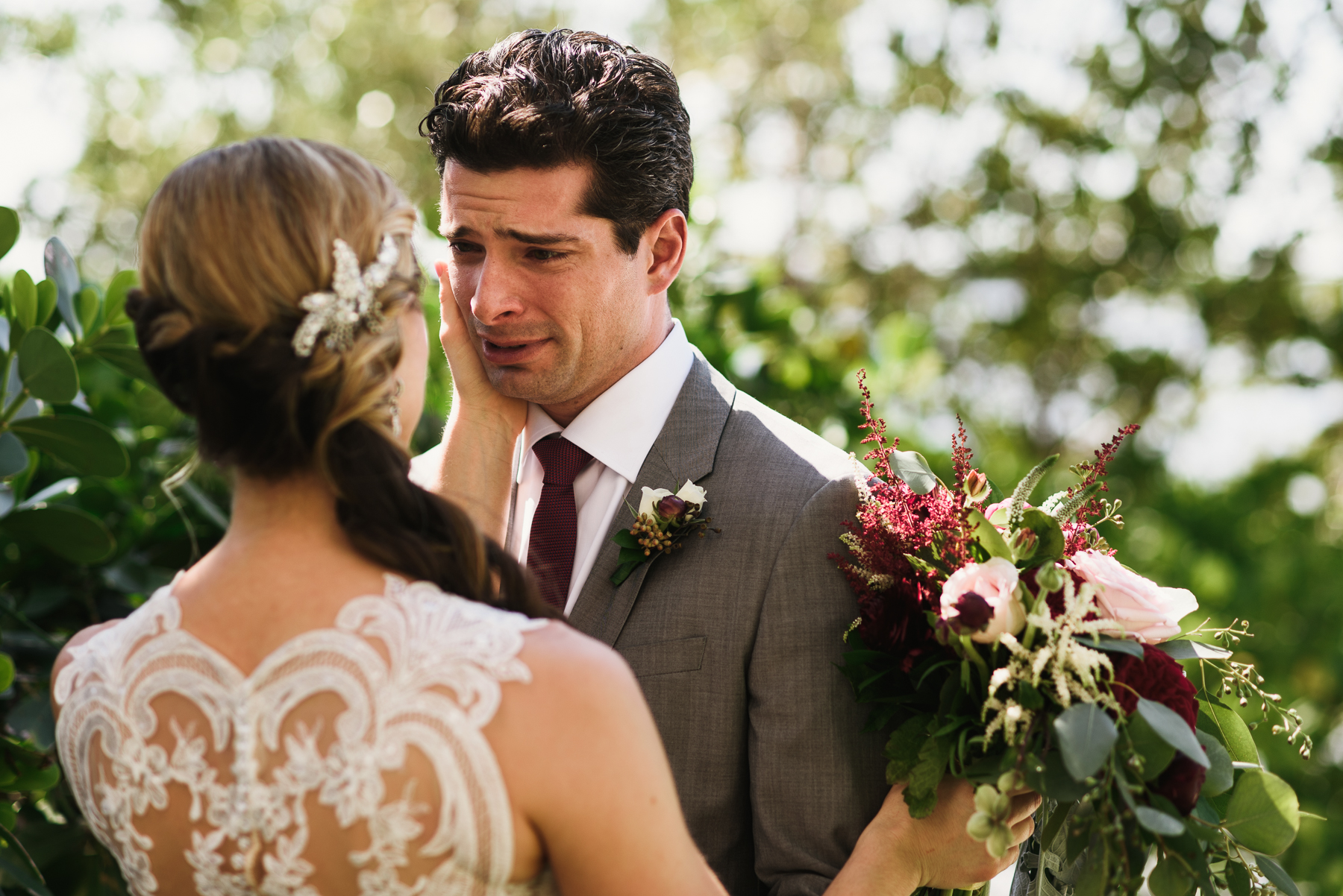 florida destination wedding first look groom crying