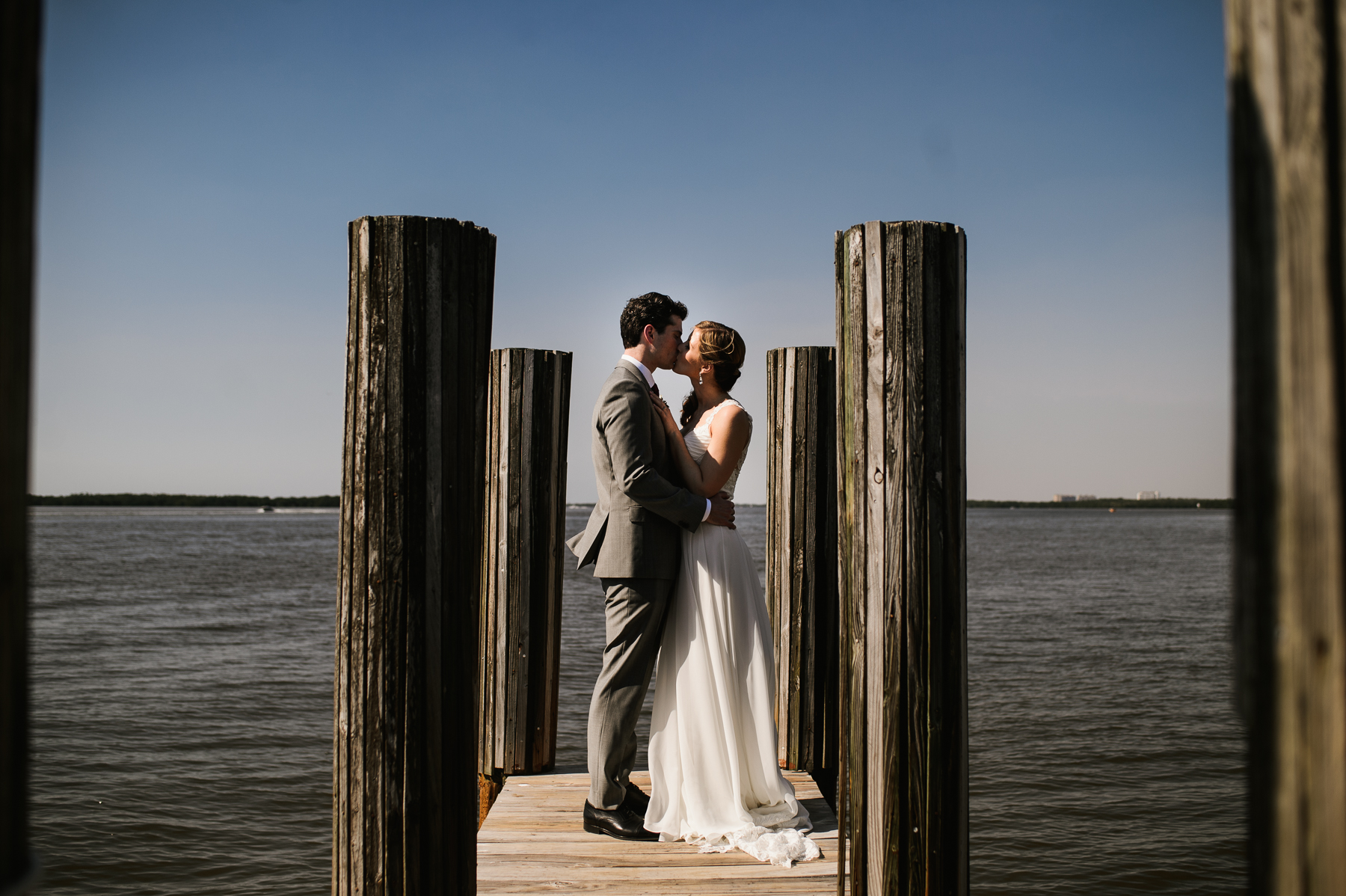 sanibel marriott pier wedding kiss couple