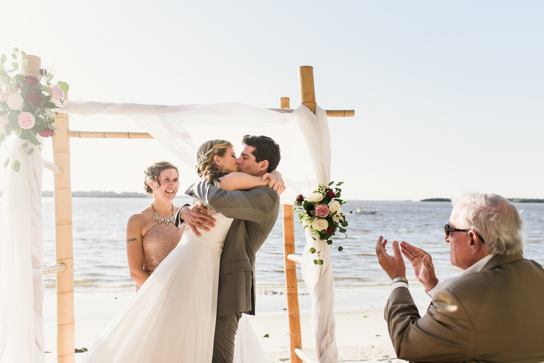 florida beach wedding ceremony first kiss