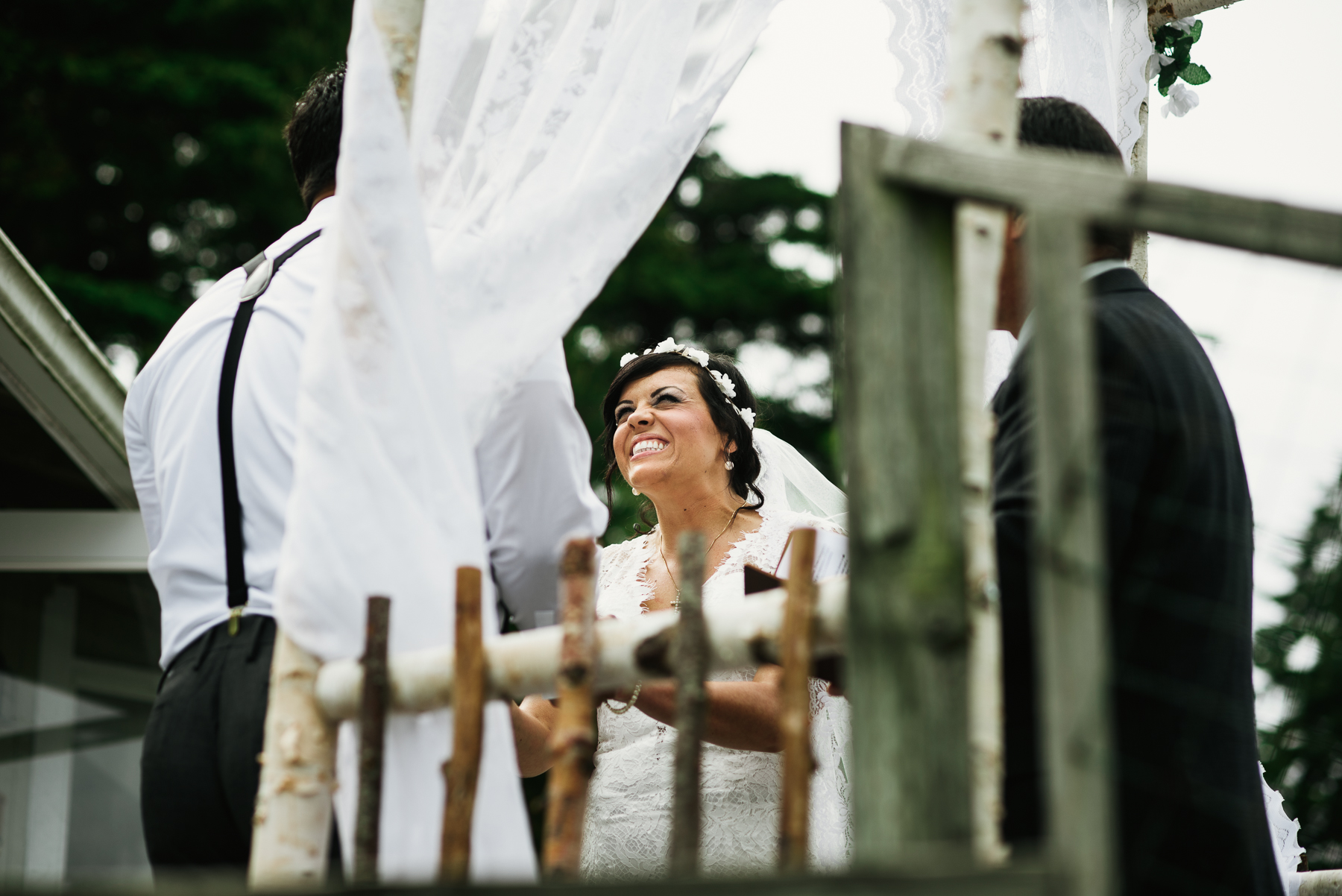 bride smiling during ceremony