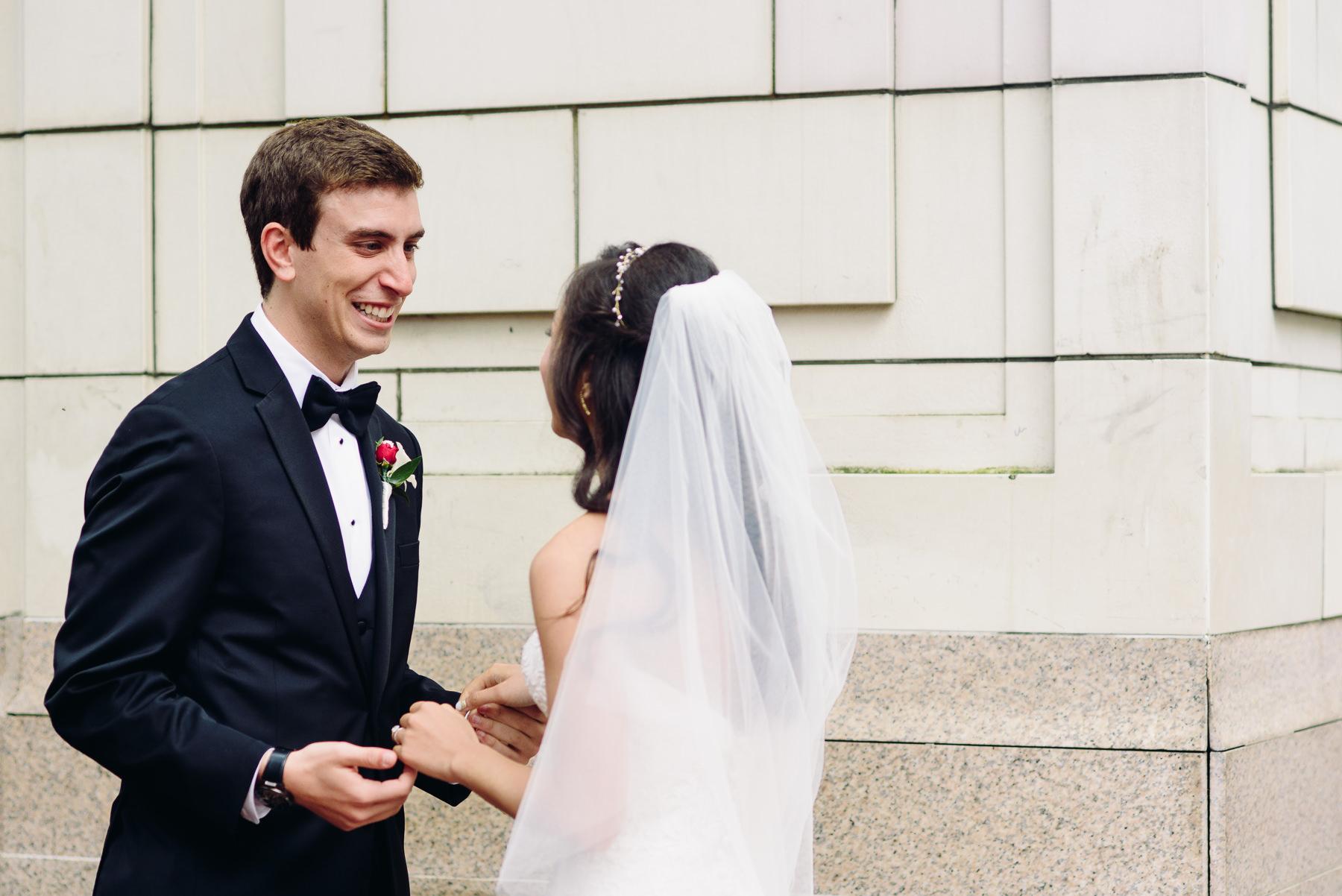 groom reaction first look hotel monaco