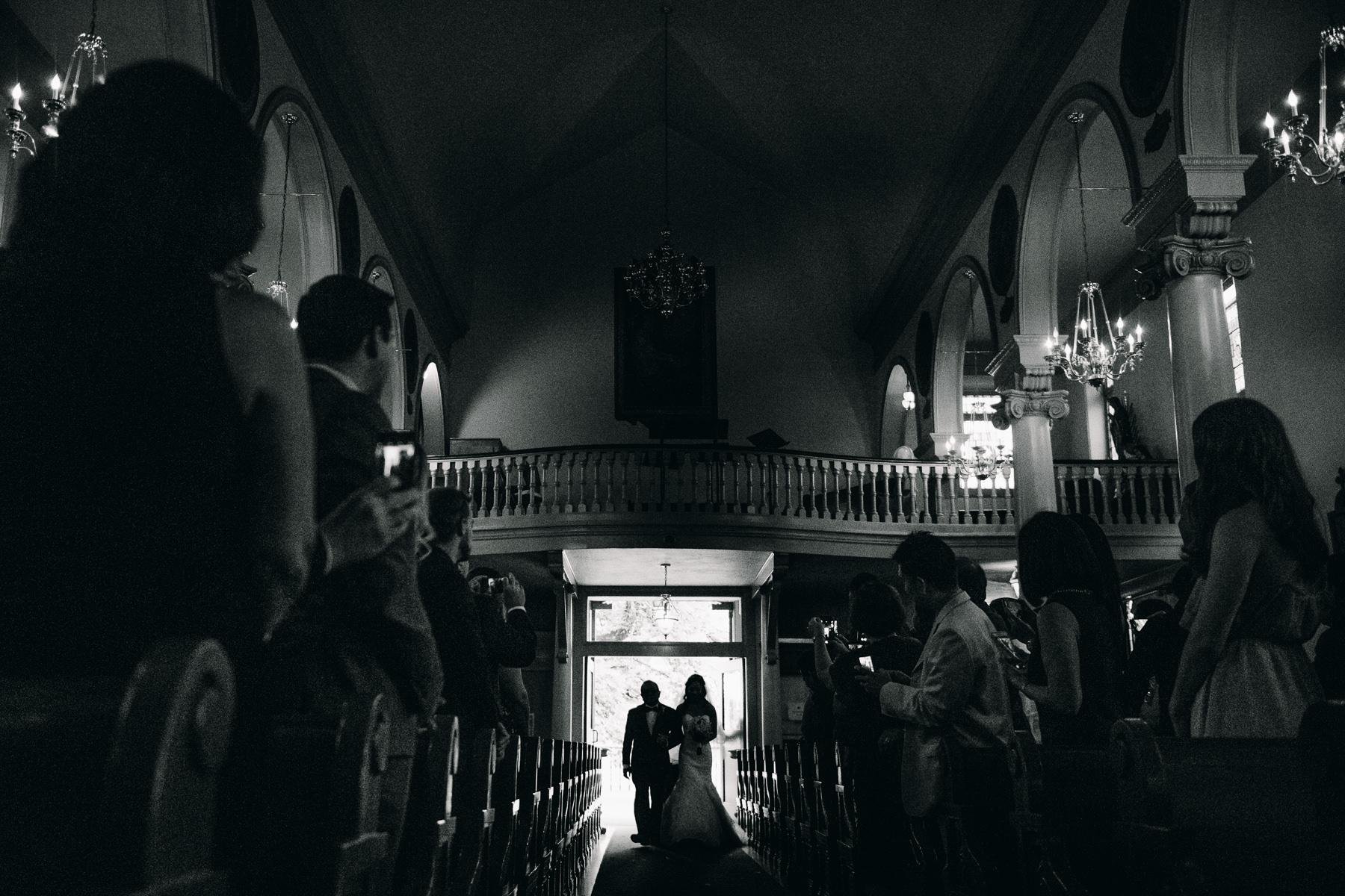 bride walks down aisle st. patrick catholic church
