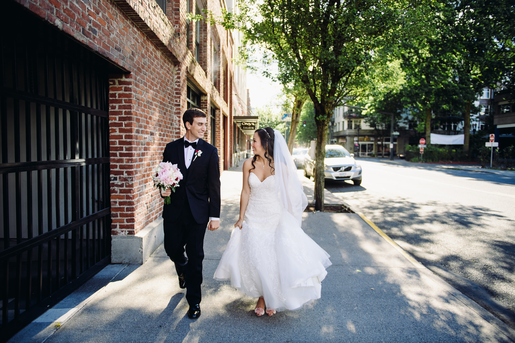 bride and groom walking downtown portland