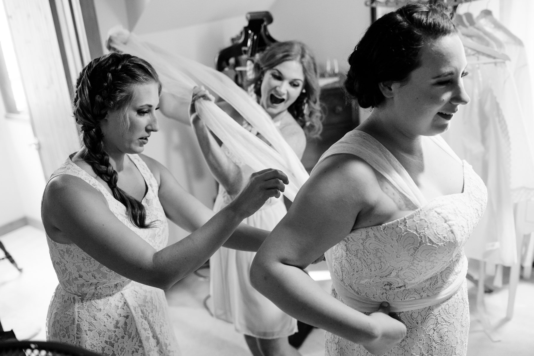 putting on wedding dress moment