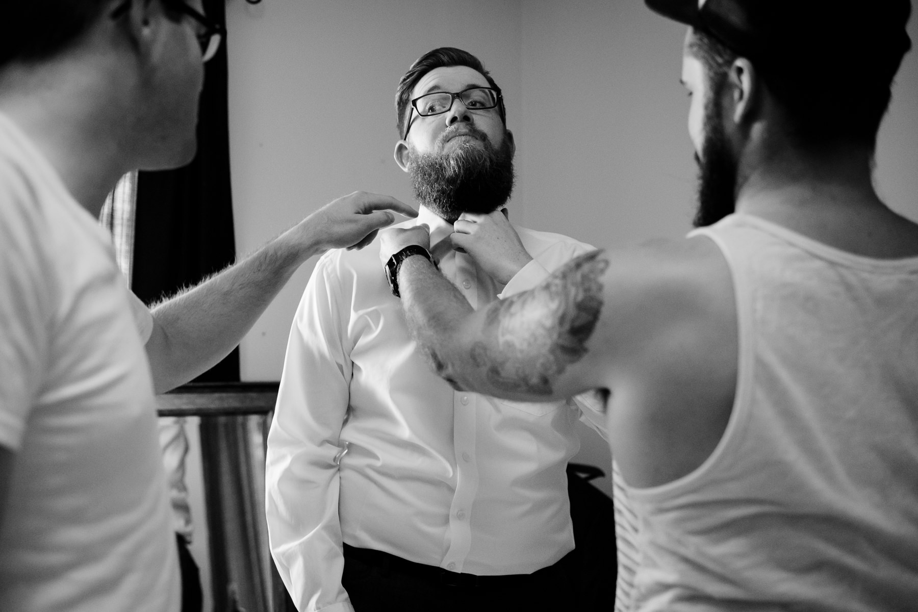 groomsmen getting ready moments