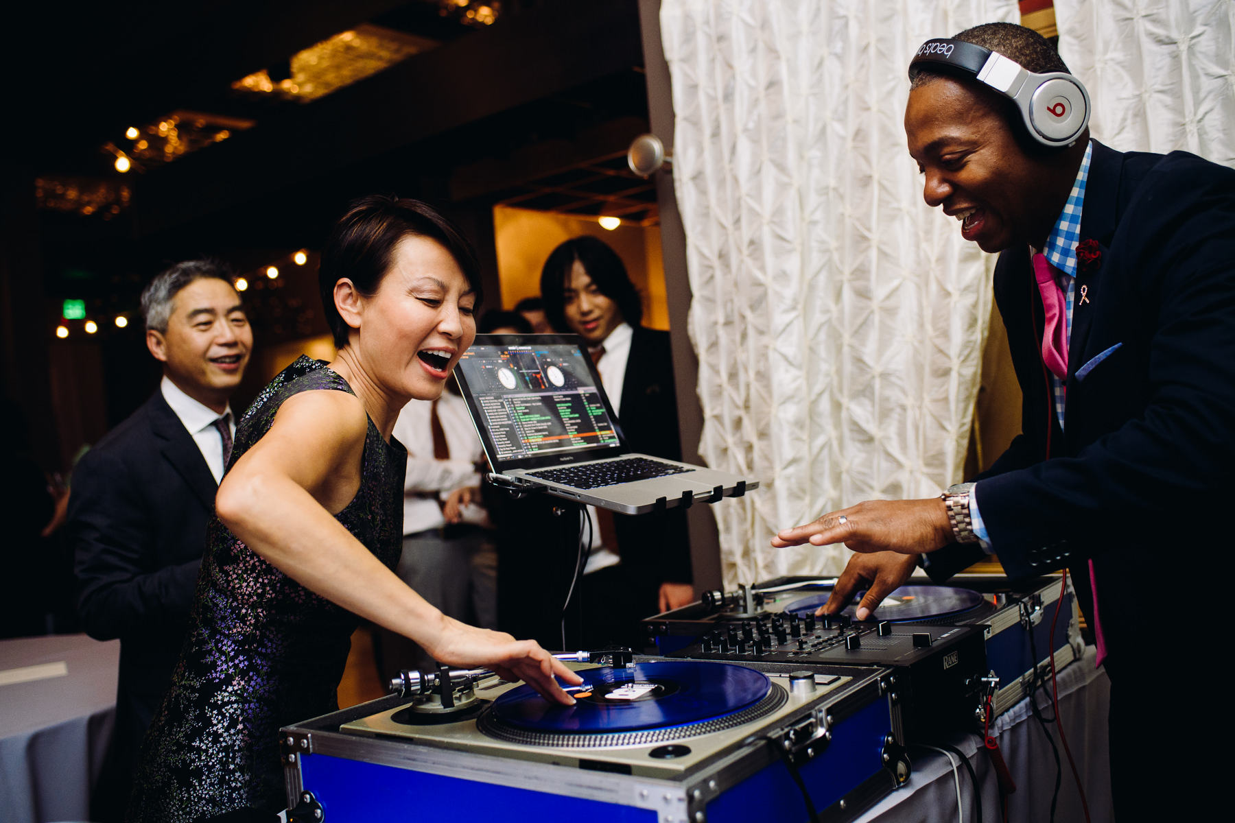 wedding guest and DJ partying