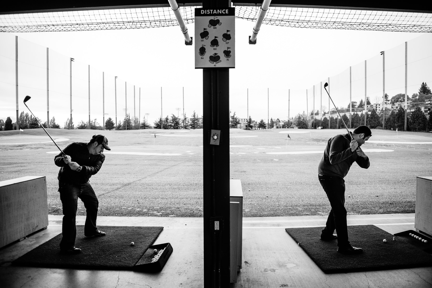 Inner Bay Golf range groomsmen wedding photo