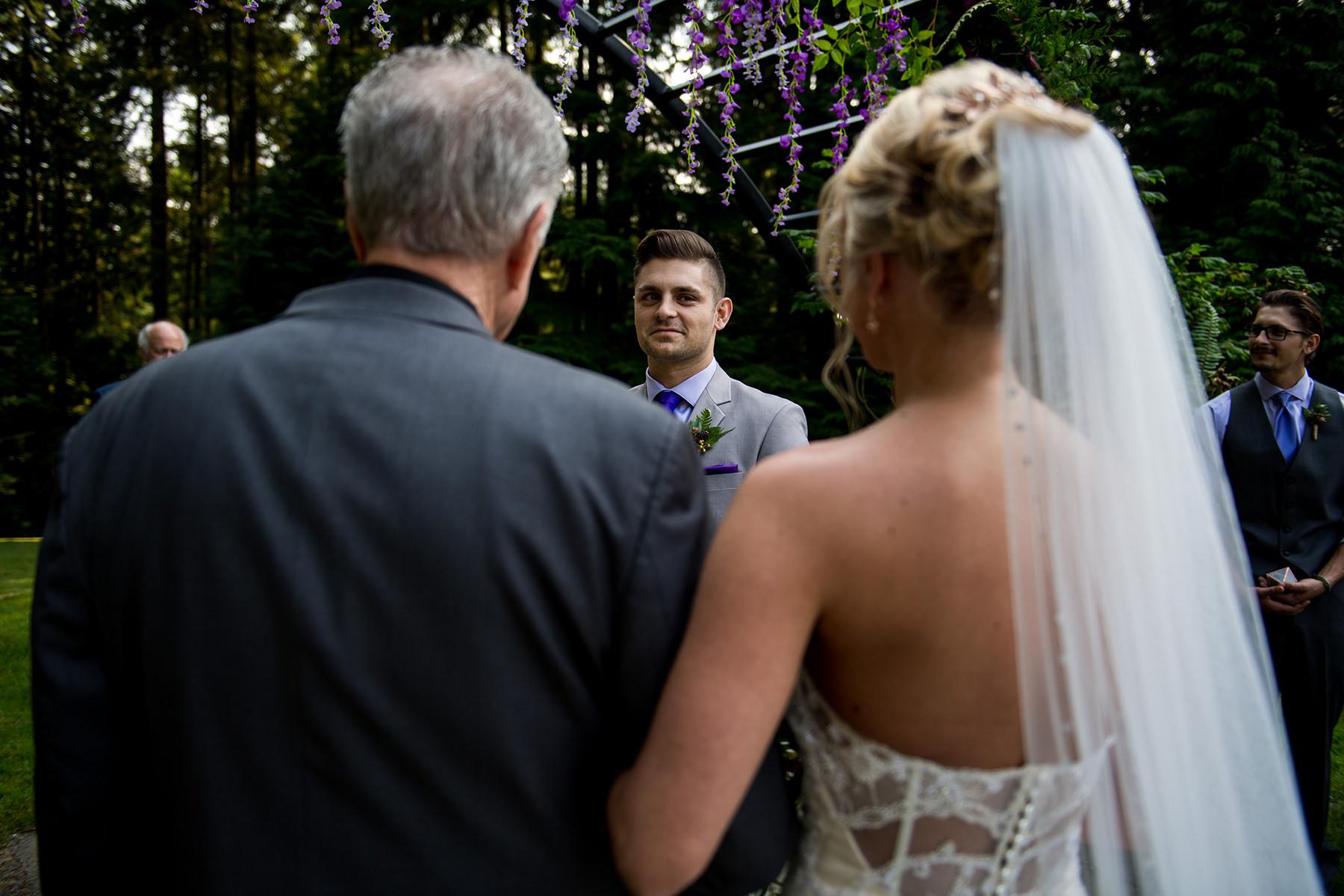 groom looking longingly at his bride