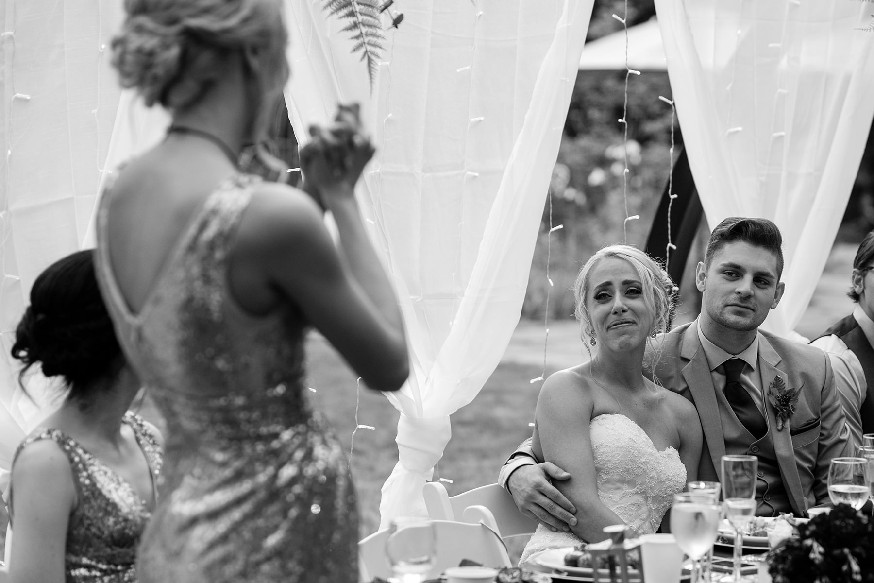 bride crying during toast