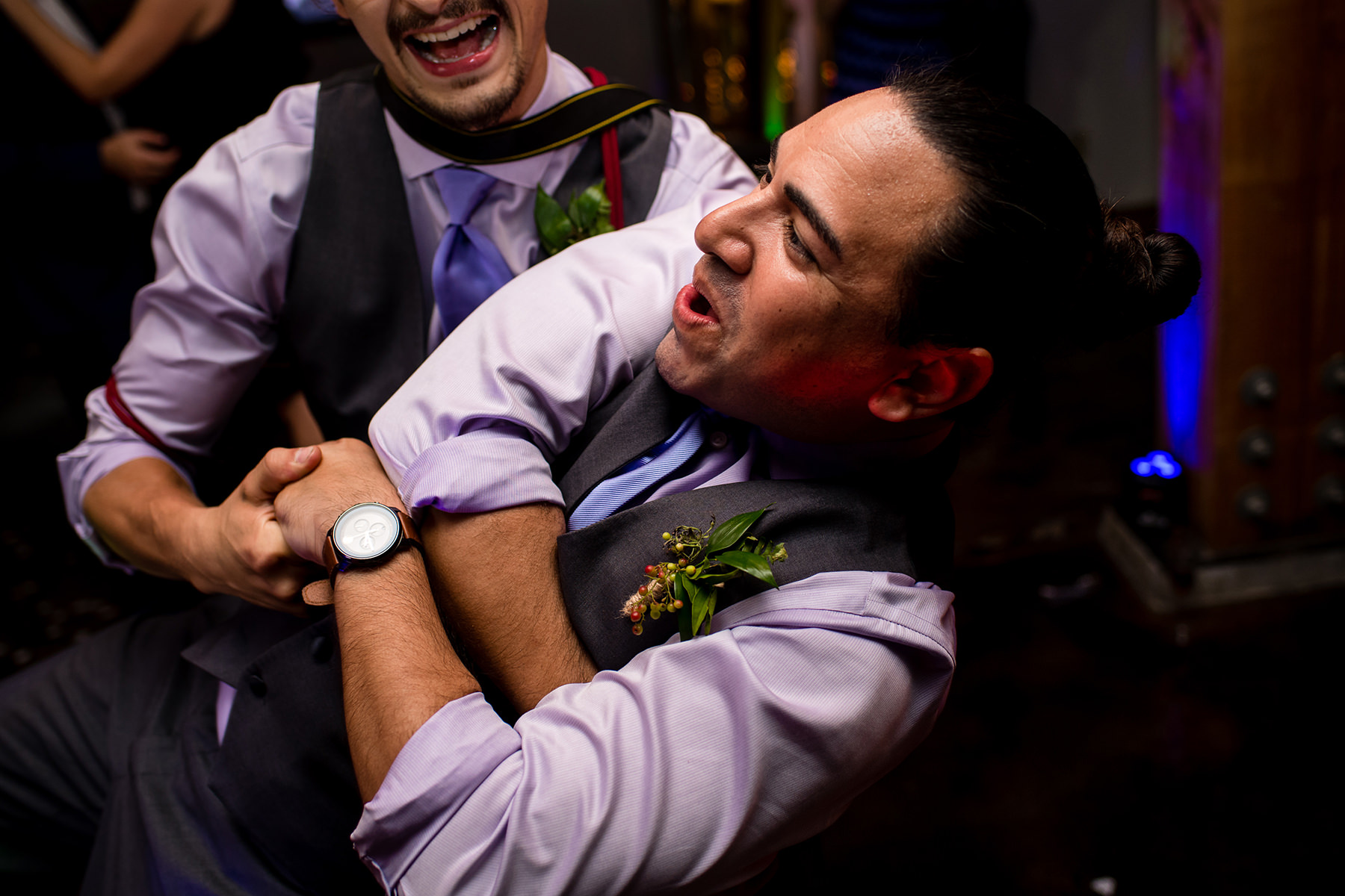 groomsmen dancing together