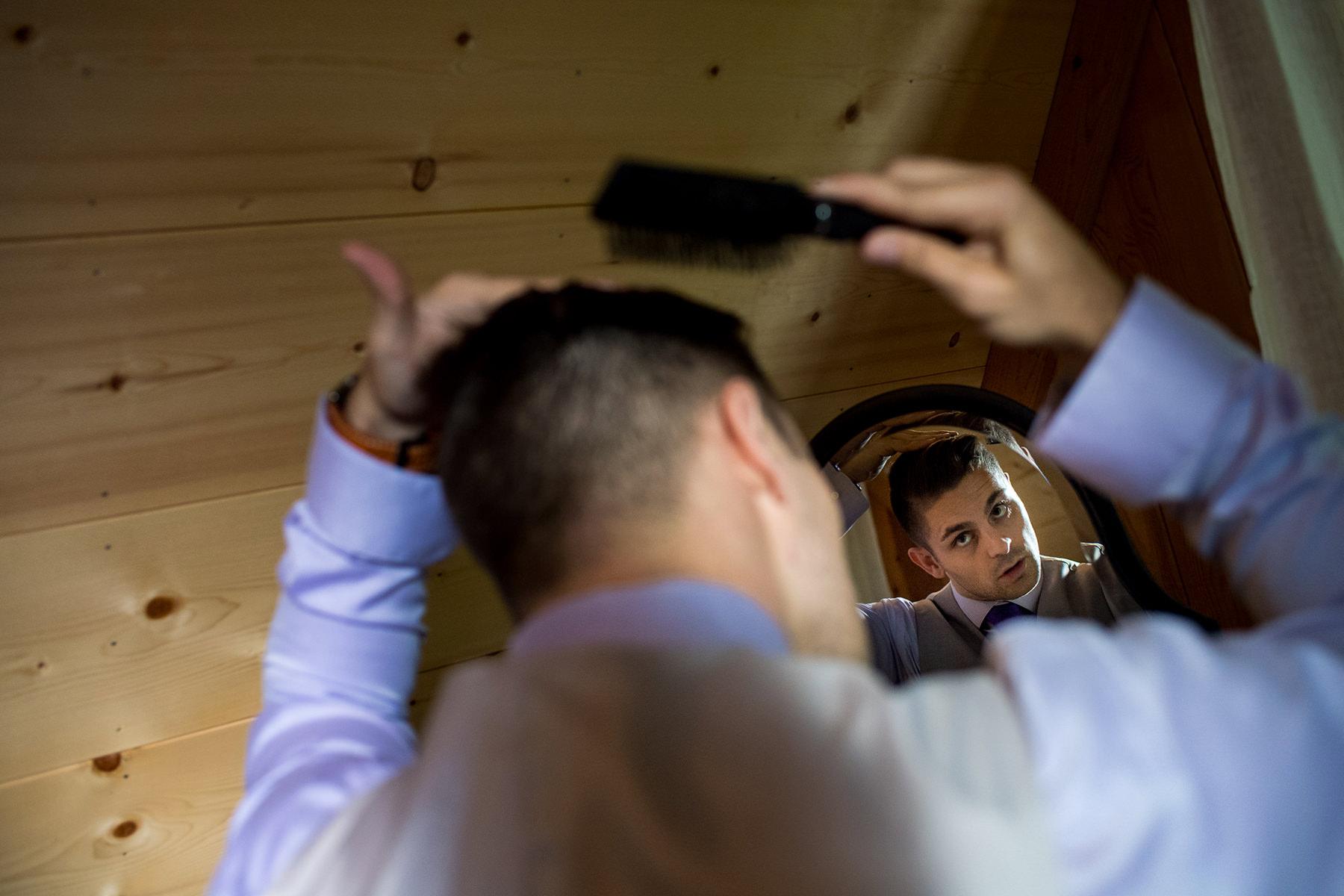 groom combing his hair