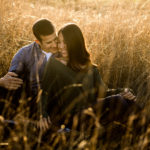 engagement session in tall grassy field
