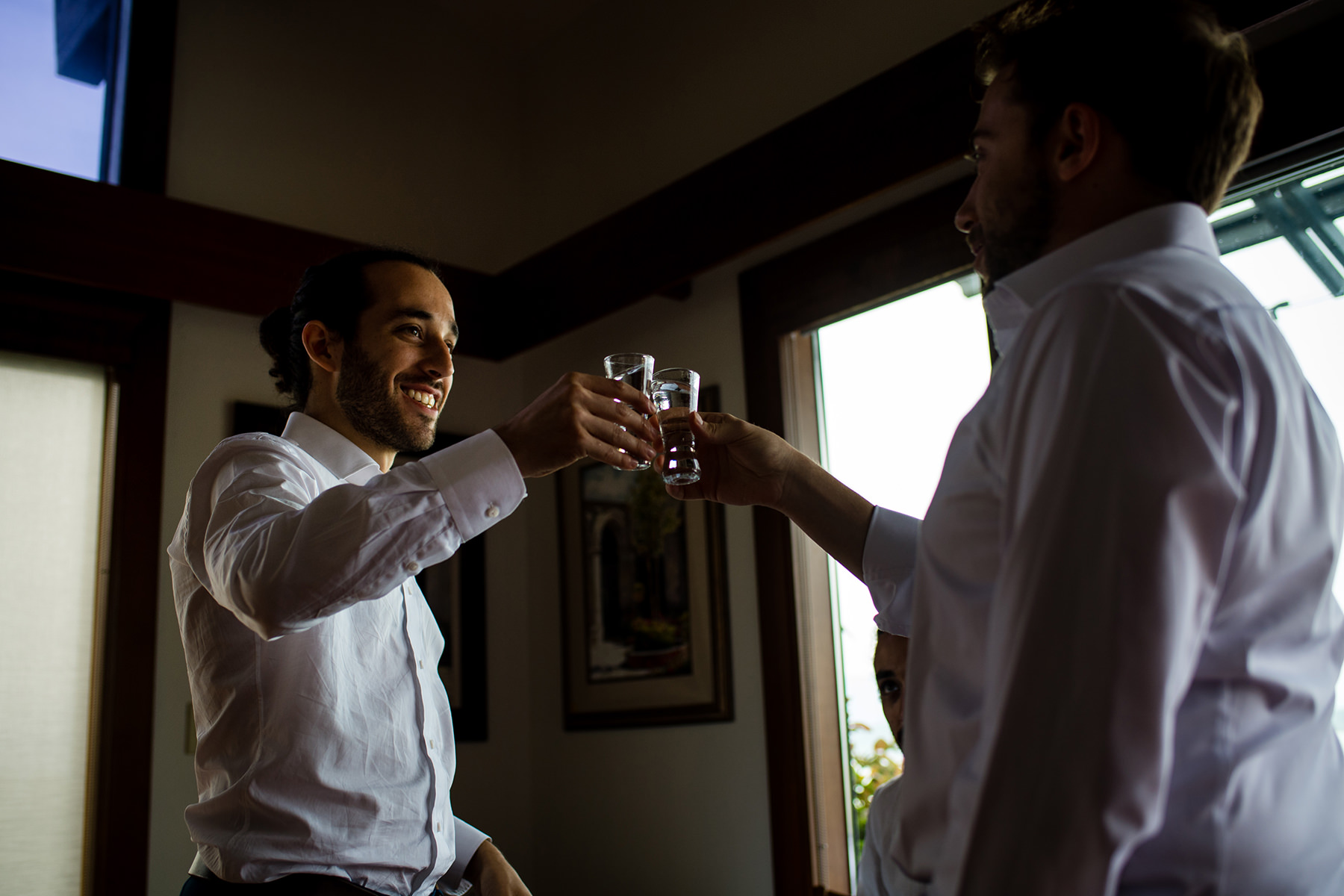 groom and friend taking a shot