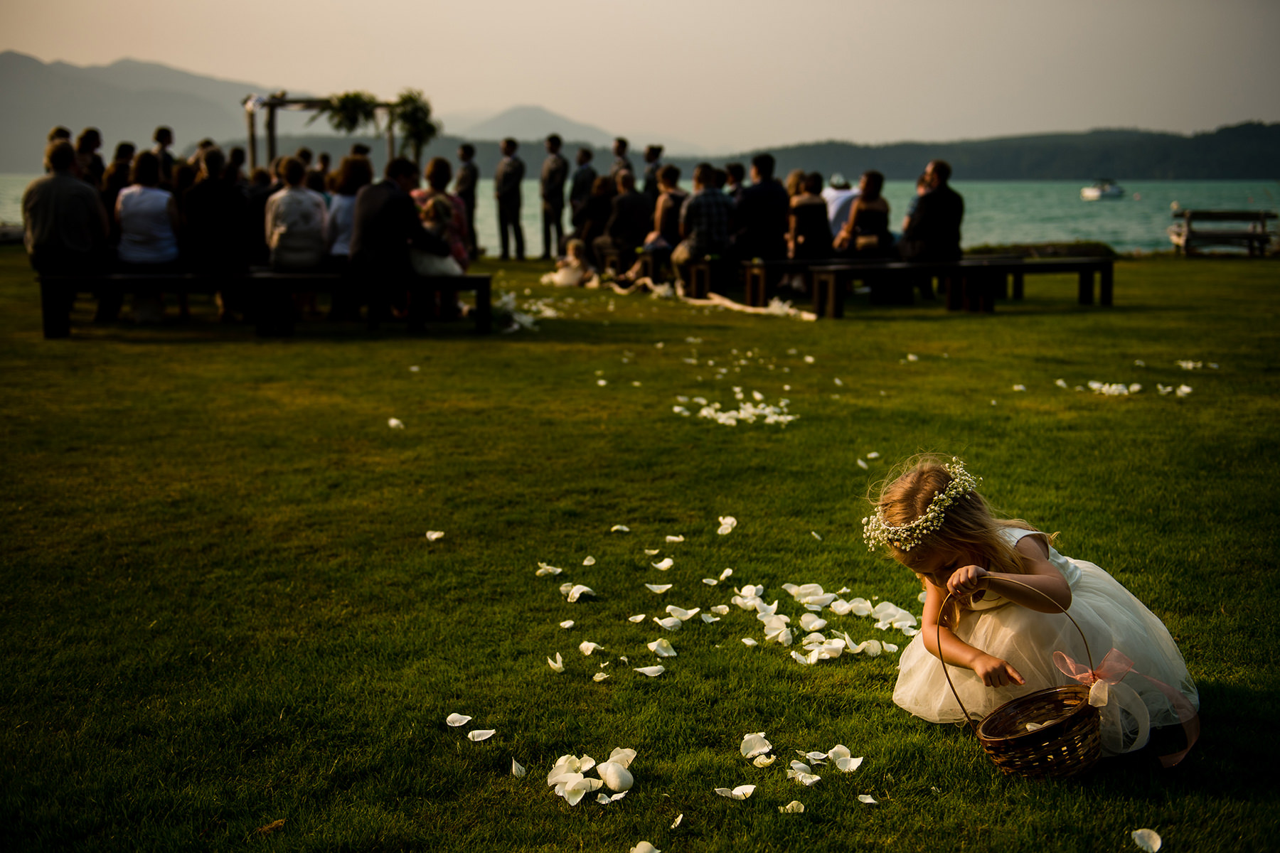 flower girl picking up flowers during wedding
