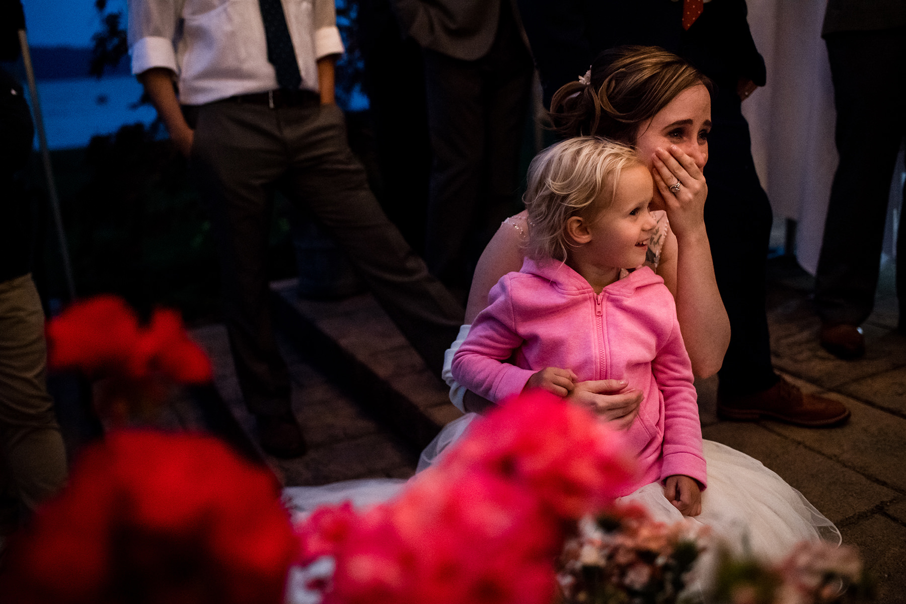 flower girl sitting on brides lap