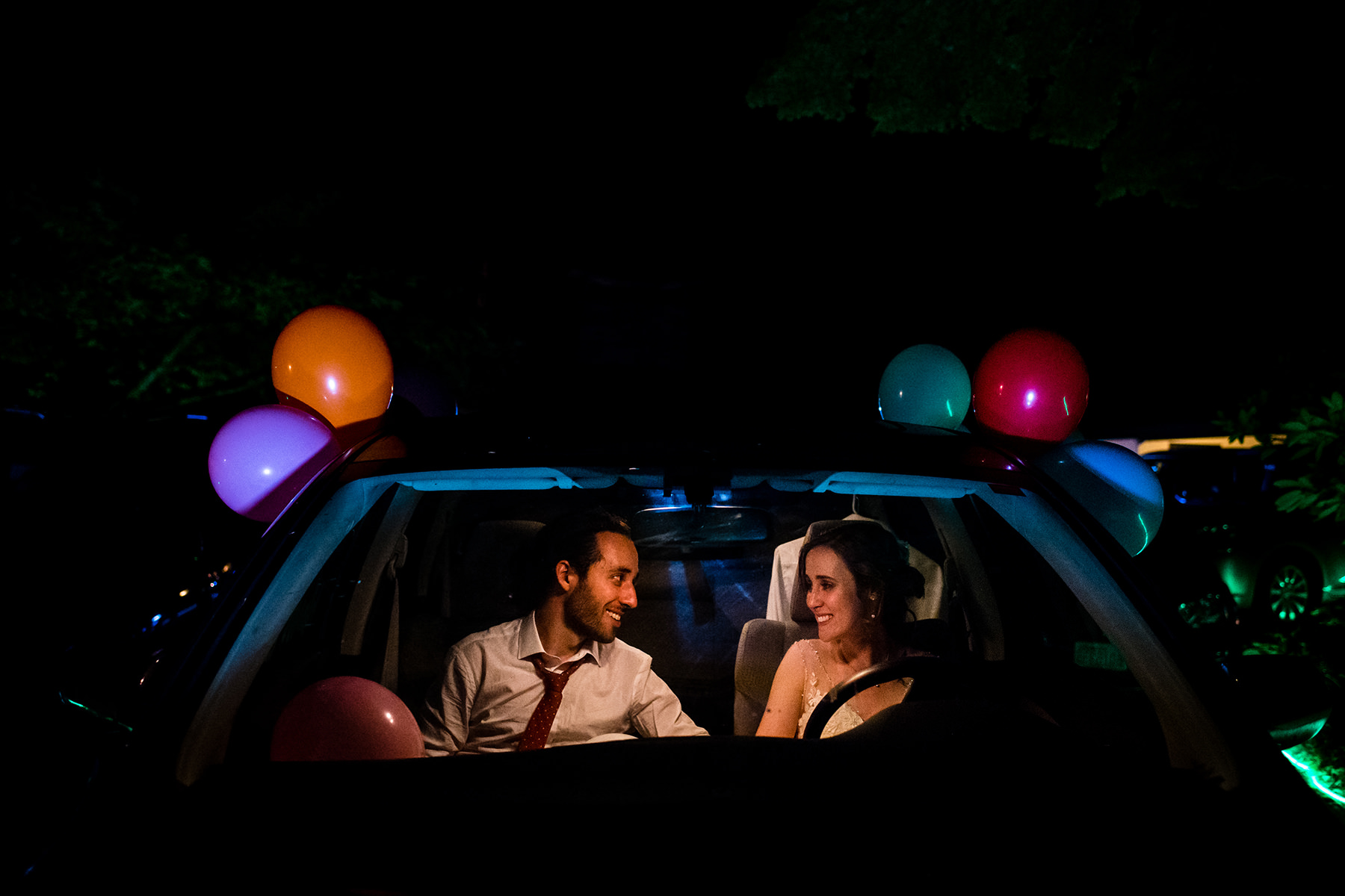 bride and groom in get away car