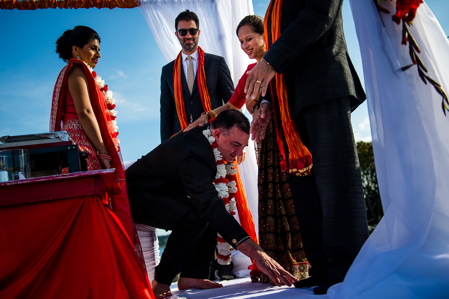 groom touching feet of brides father