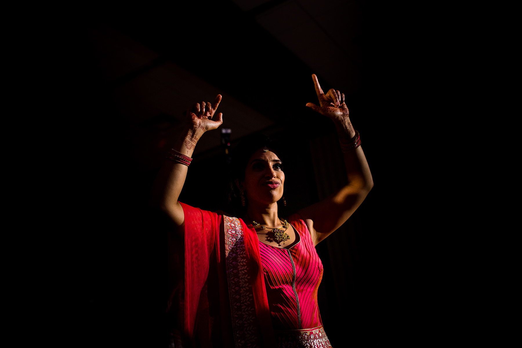 bride dancing in wedding sari